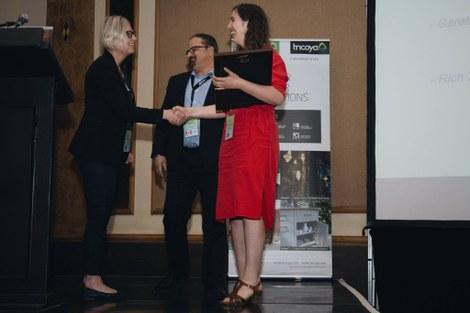 Liselotte De Ligne (in red) of UGent-Woodlab wins Gareth Williams Award 2018 on the IRG49 conference