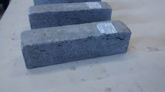 Figure 1. Mortar bars for strength testing (Expansion due to elemental Al content is also visible)